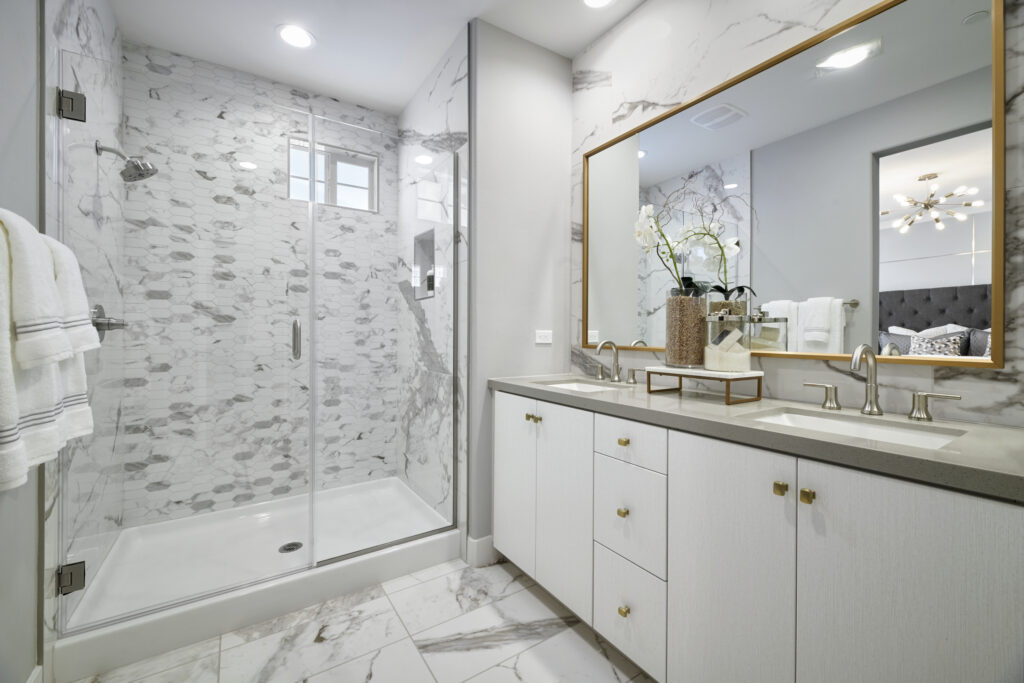 The master bathroom at Rancho Soleo features different types of luxurious marble bath tile.