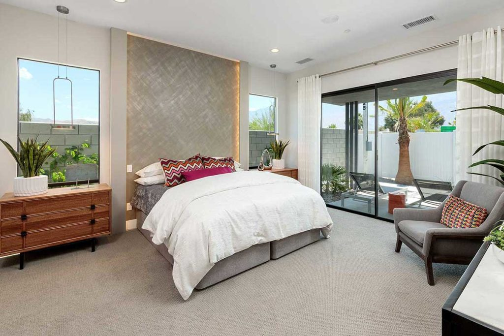 Master bedroom with Palm Springs vibe designed by interior design firm Design Tec, Inc. In collaborating with GHA Properties. Photography by Mark Davidson Photography.
