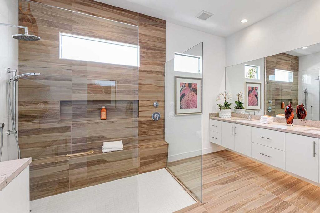 Master bathroom in Palm Springs, California. Modern and clean lines with wood-look tile, interior design by Design Tec.